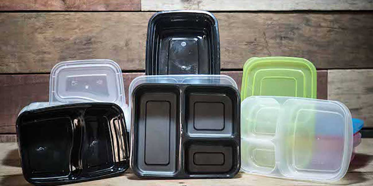 Meal Prep Containers: A Complete Review & 12 Best Containers various meal prep containers placed on a wooden table and backdrop