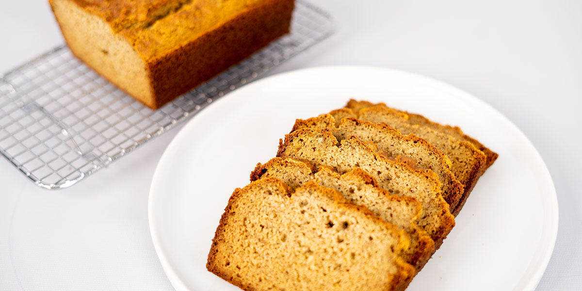 Paleo Gluten Free Bread Recipe Sliced and Whole on a Plate and Cooling Rack