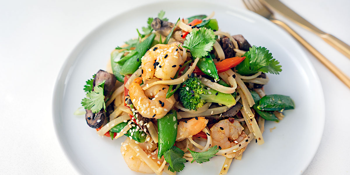 shrimp stir-fry with noodle recipe plated on a white round plate