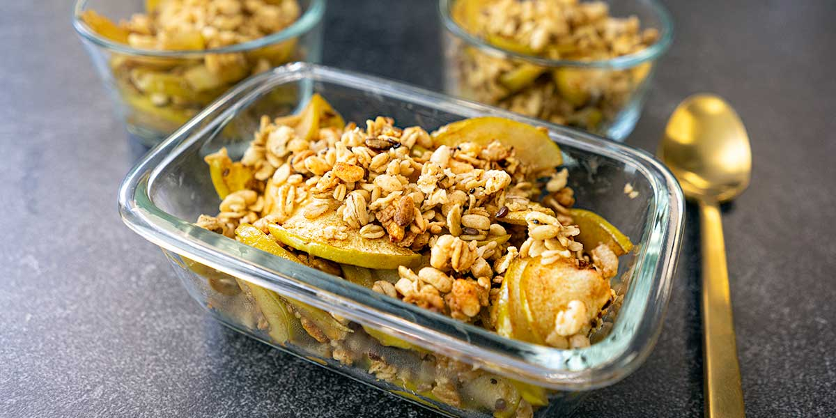easy apple crisp recipe on glass rectangular meal prep containers