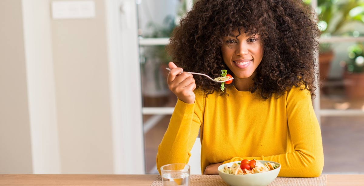 how to count carbs woman eating healthy food
