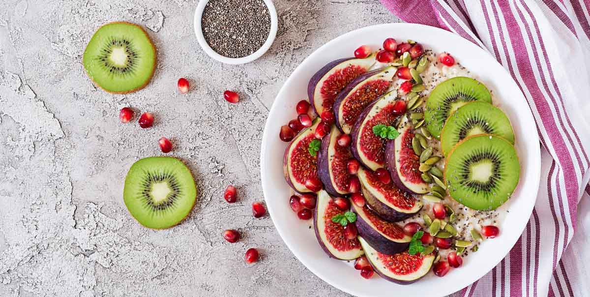 bowl of chia pudding with kiwi figs and pomegranate fruit