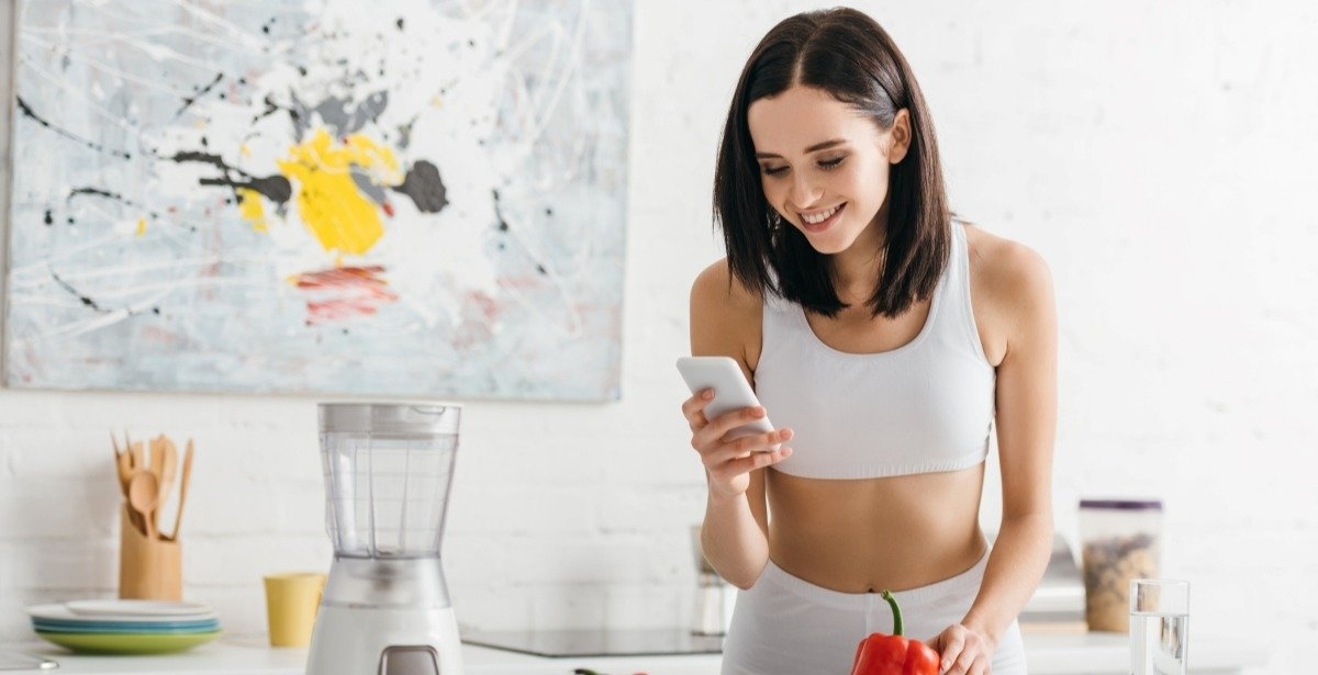 female-weighing-food-for-meal-prep-in-kitchen