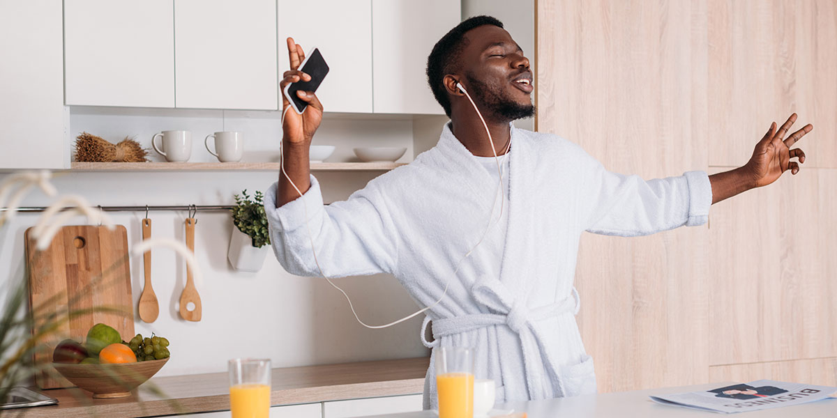 4 Vegan Breakfast Recipes For Plant Based Power. man dancing to music in bathrobe